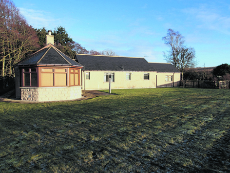 This three-bedroom detached bungalow is set on the banks of the River Dee
