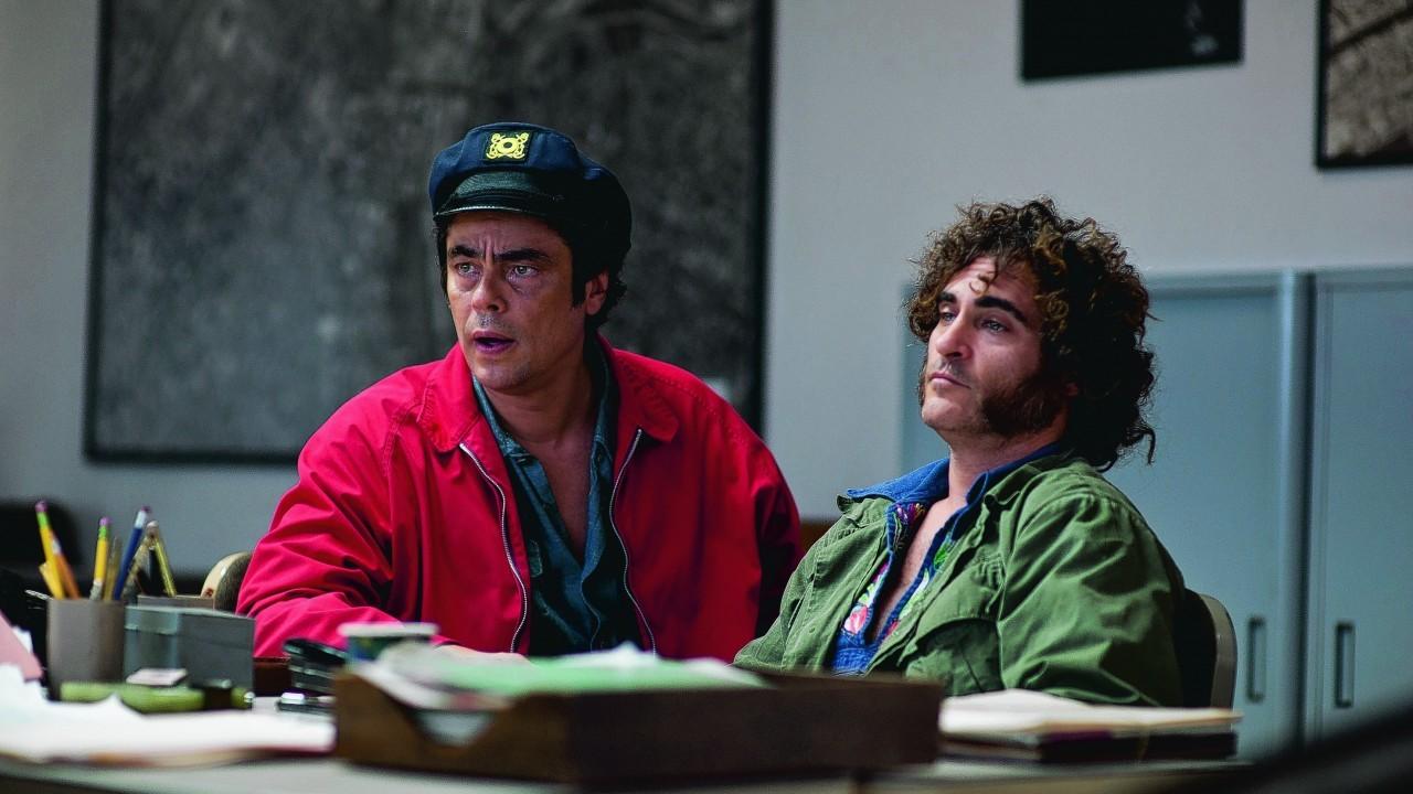 Benicio del Toro as Sauncho Smilax and Joaquin Phoenix as Doc Sportello