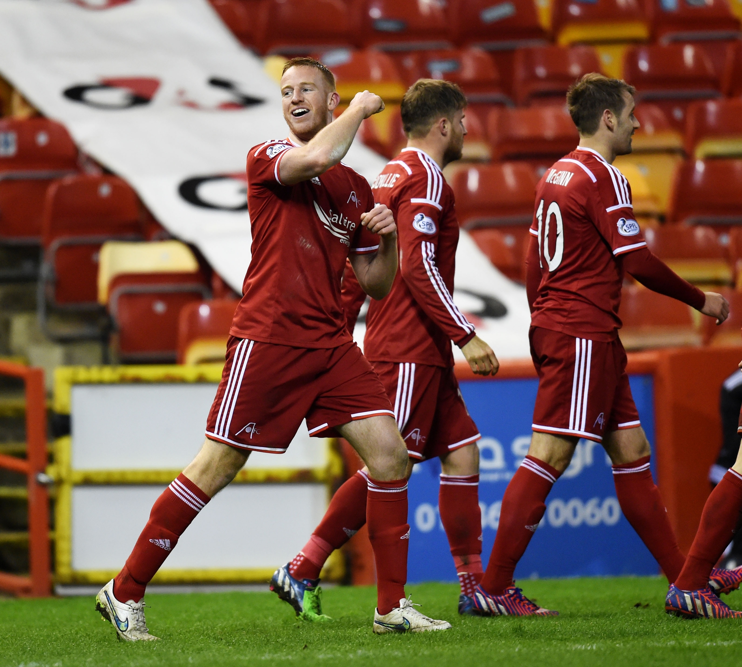 Adam Rooney celebrates his most recent goal, on Friday against Motherwell