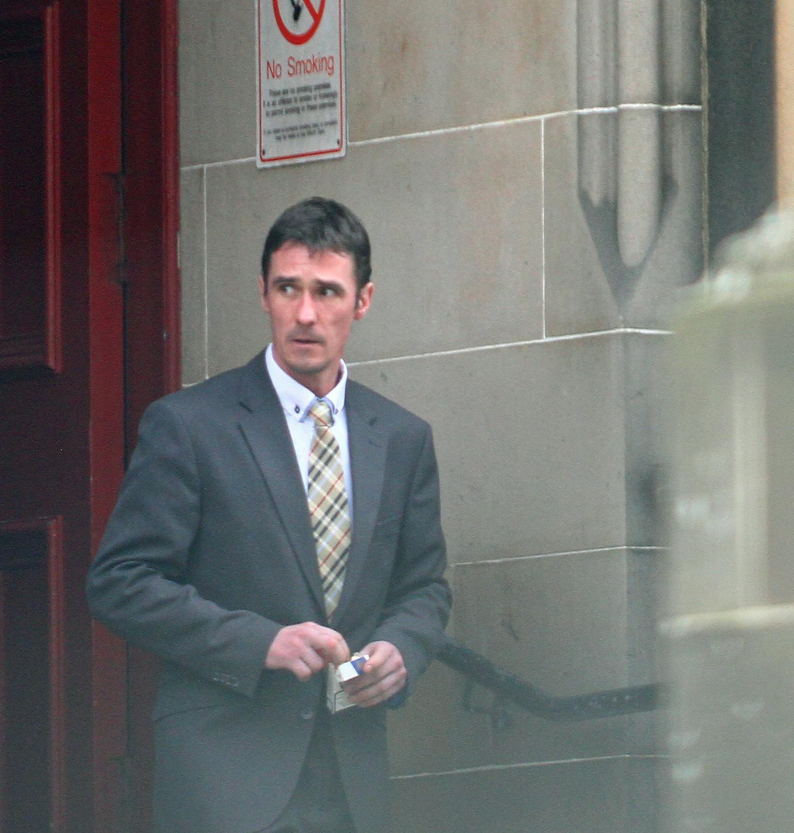 Barry Gunn leaving court