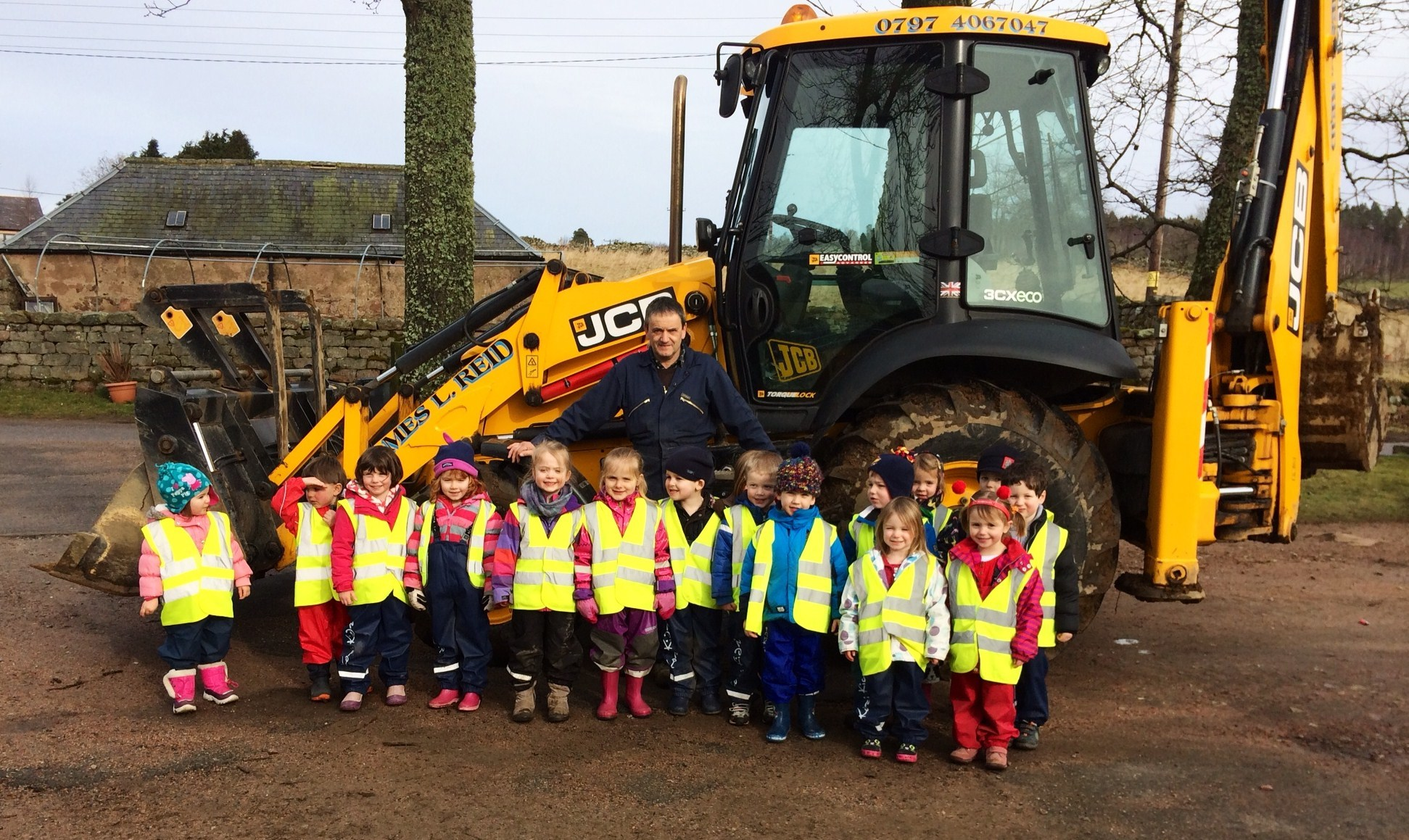 Ballogie Nursery children getting ready for path construction together with James Reid, local contractor and resident, who will be building the path.