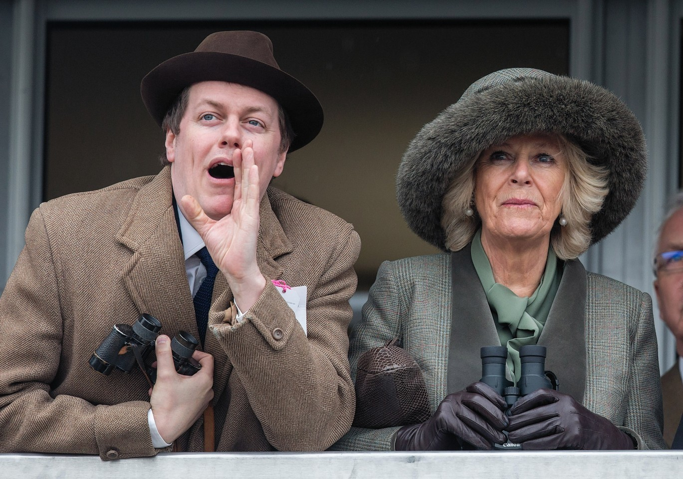 Camilla, Duchess of Cornwall watches a race from the temporary Royal Box with her son Tom Parker Bowles