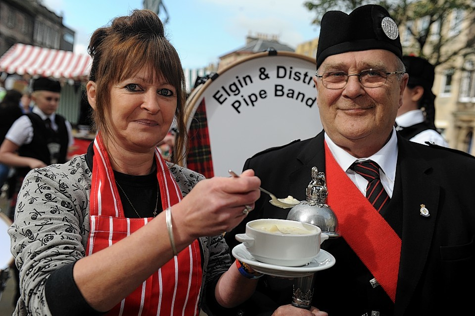 Cullen skink champion Tracy Fuller with Elgin Drum Major Frank Munro.