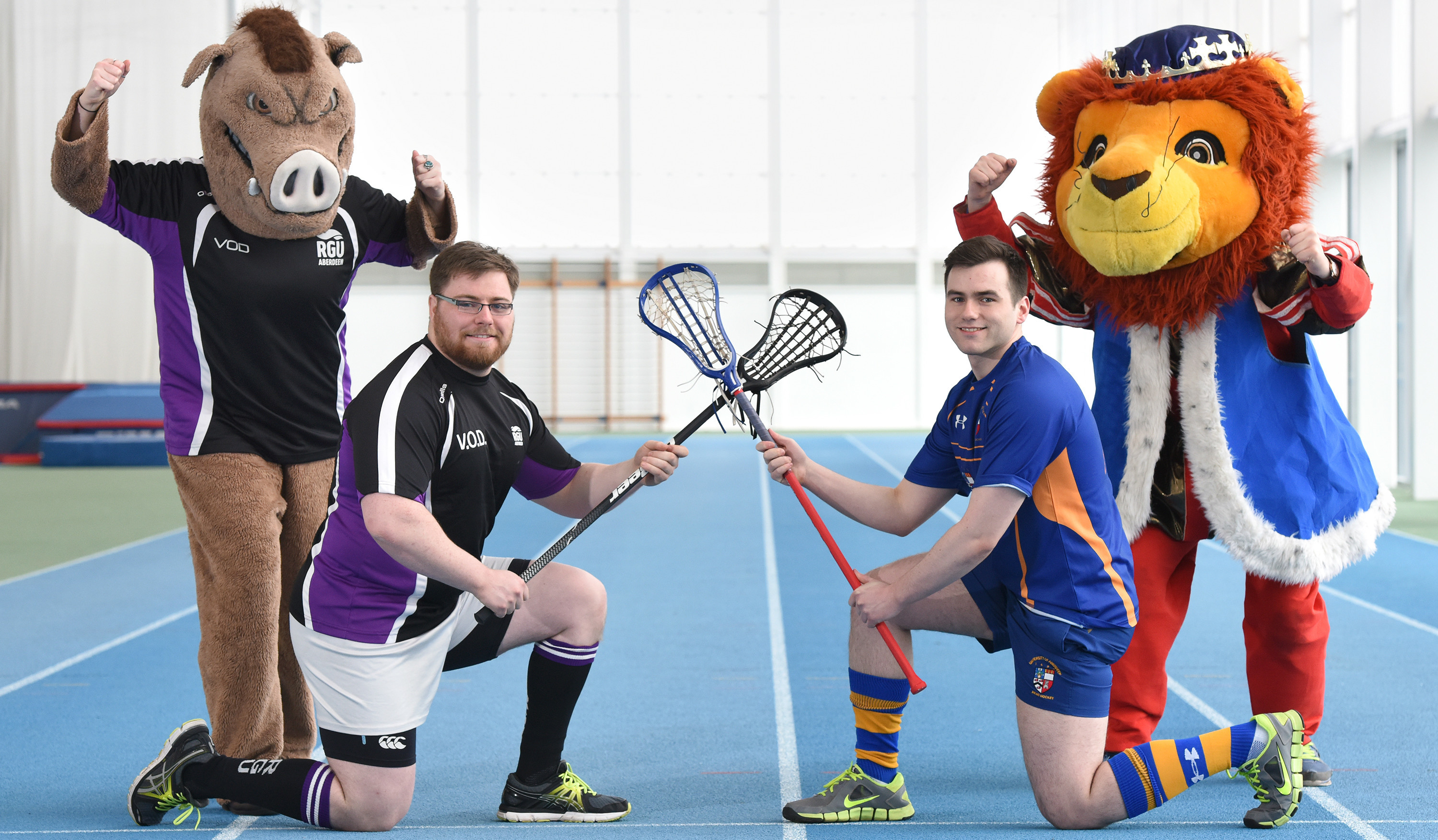 Sports Presidents Vinny O'Donovan (left) and Mark McCorkell are gearing up for the Granite City Challenge along with RGU mascot Bobby the Boar, and Rex the Lion from the University of Aberdeen.