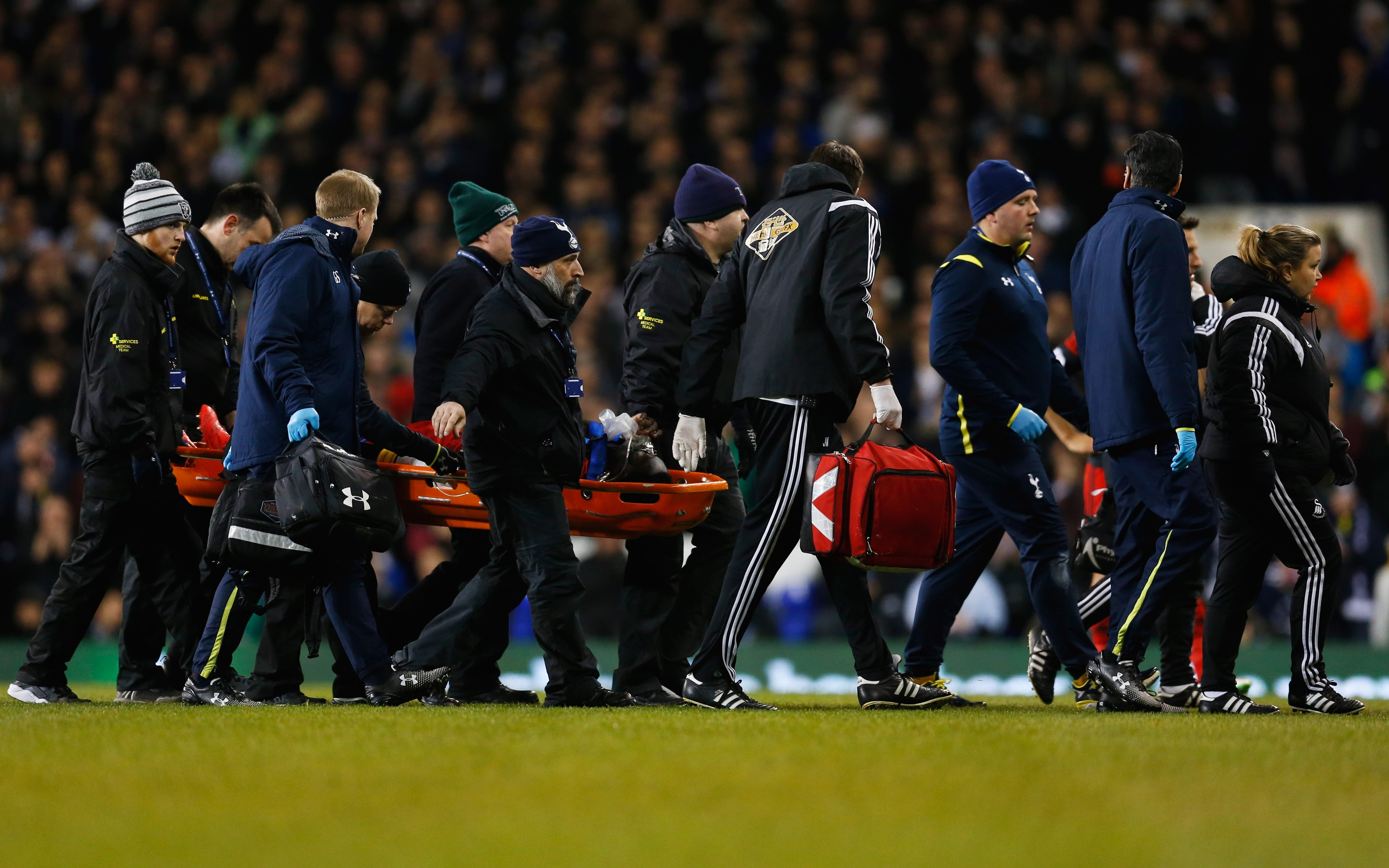 Bafetibis Gomis of Swansea City is stretchered off during the Barclays Premier League match between Tottenham Hotspur and Swansea City at White Hart Lane