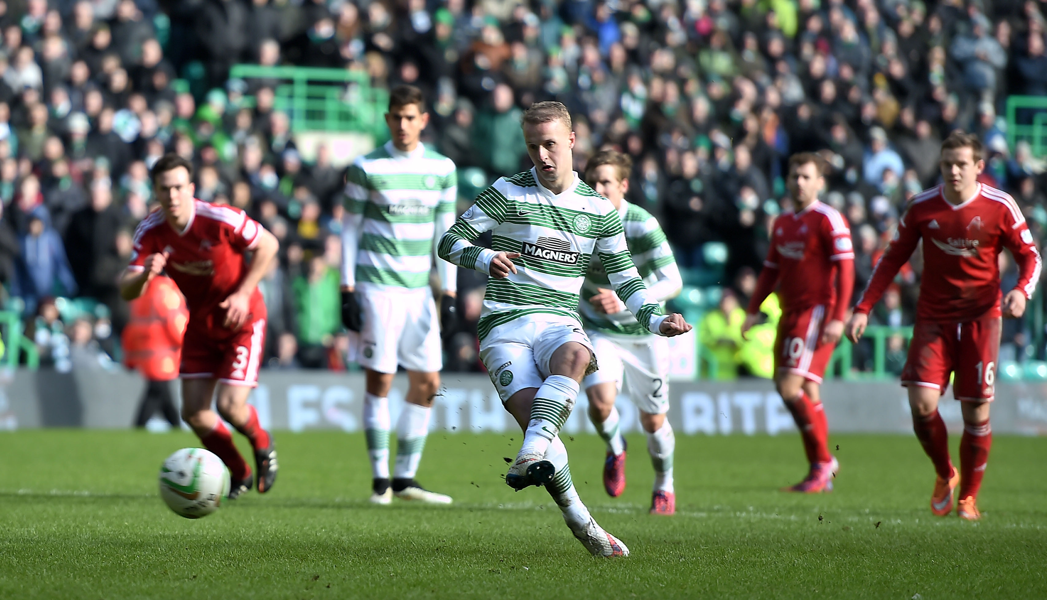 Leigh Griffiths strokes home Celtic's second goal on Sunday, from the penalty spot.