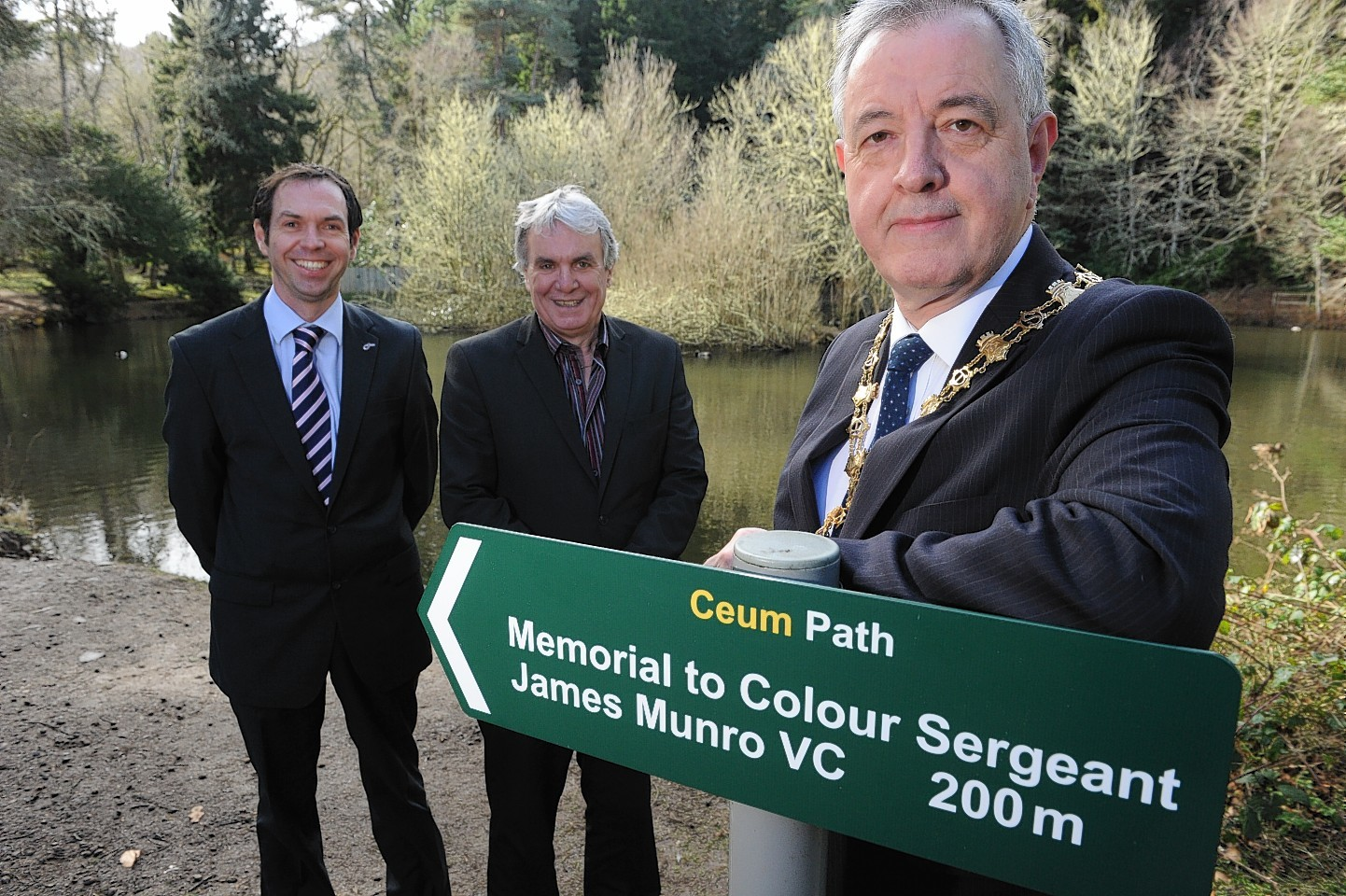 Colin Souter of Robertsons, Councillor Graham Ross and Provost Alex Graham.