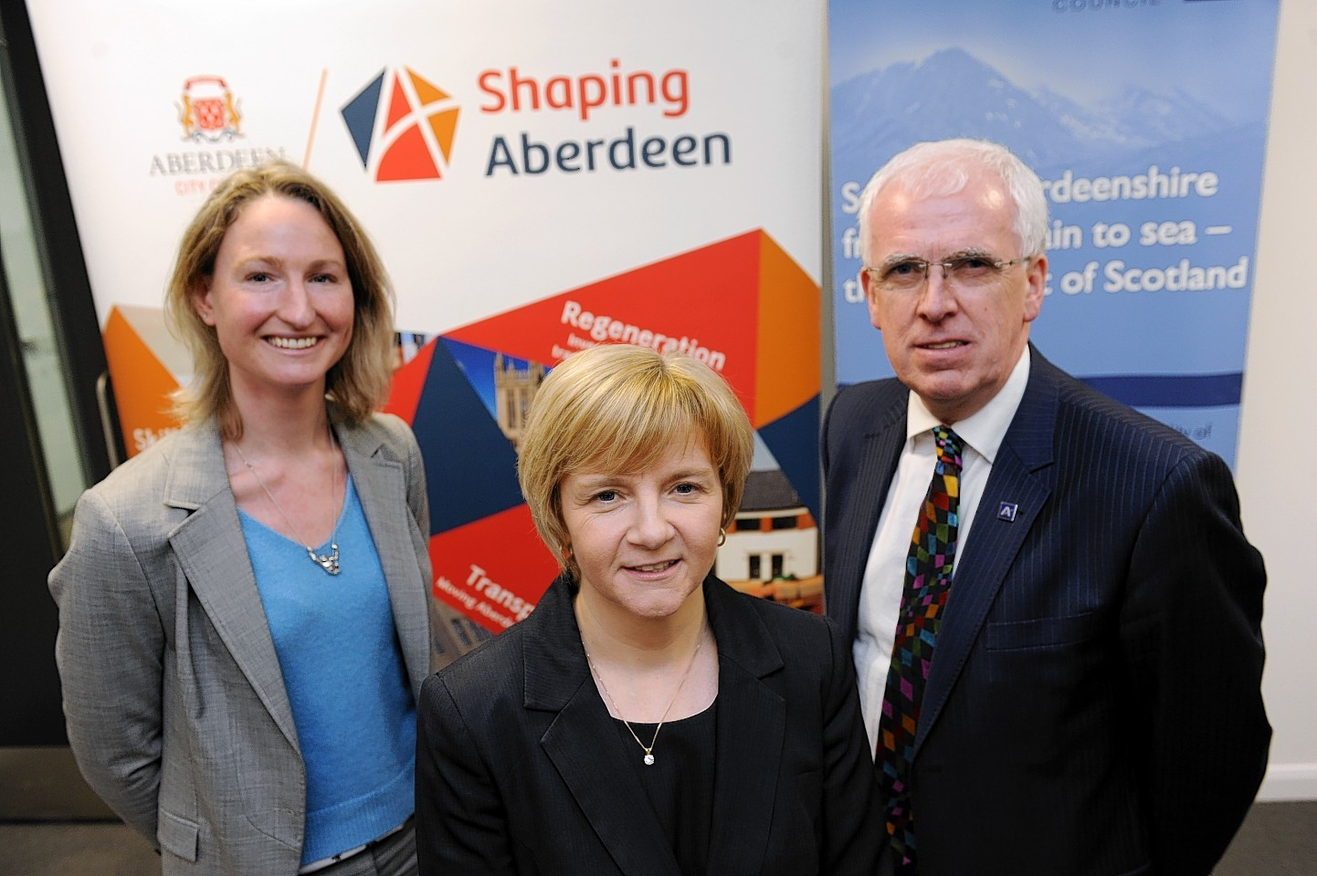 Jenny Stanning, Jenny Laing and Jim Gifford discussing the deal