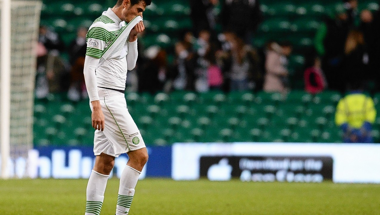 A disappointed Nir Bitton trudges off the pitch