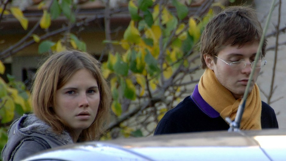 Amanda Marie Knox, left, and Raffaele Sollecito, stand outside the rented house where 21-year-old British student Meredith Kercher was found dead.