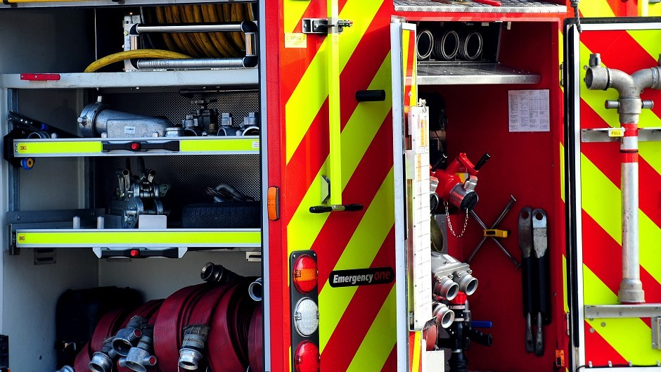 Firefighters have cut a man from his car after a crash