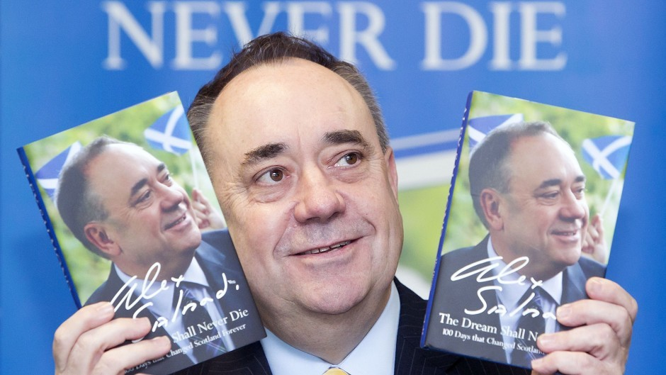 Former First Minister Alex Salmond with his new book The Dream Shall Never Die during a signing in Glasgow