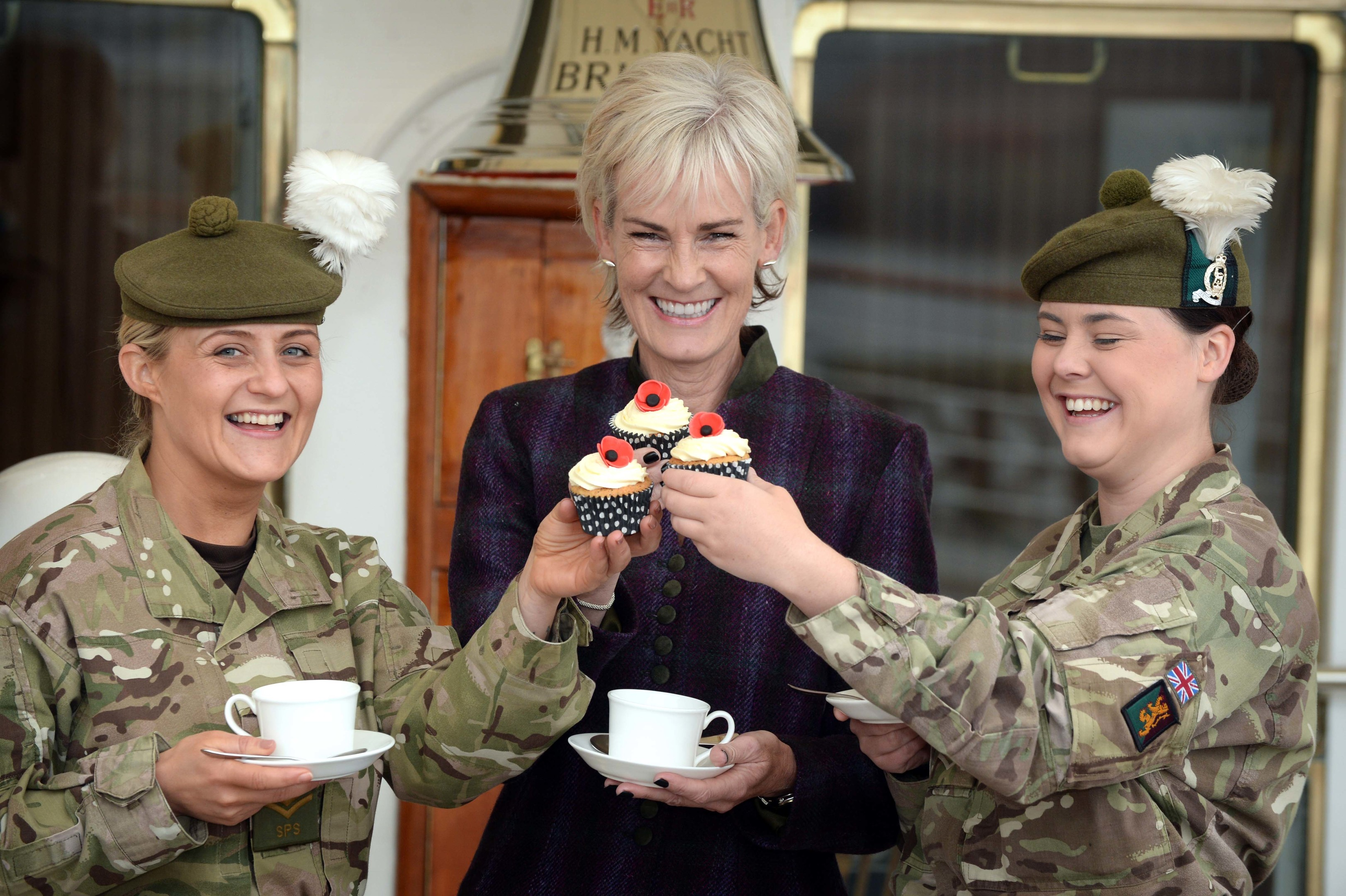 Judy Murray and Lance Corporal Amy  Sutherland (LR with Sergeant Stephanie Sanderson (L)  enjoy Tea and cakes onboard HMS Britannia
