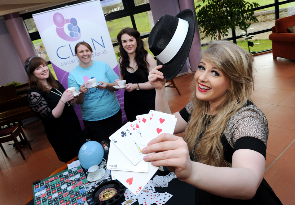RGU events management students (from left) Jenni Chandler, Joanne Lamb and Jade Hough with Steph Dowling, CLAN fundraising co-ordinator, preparing for a 1920's style casino night fundraiser for CLAN organised by the students.