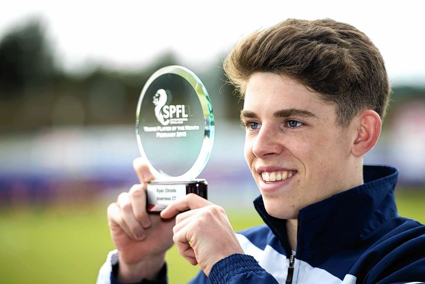 Christie poses with his young player of the month award for February