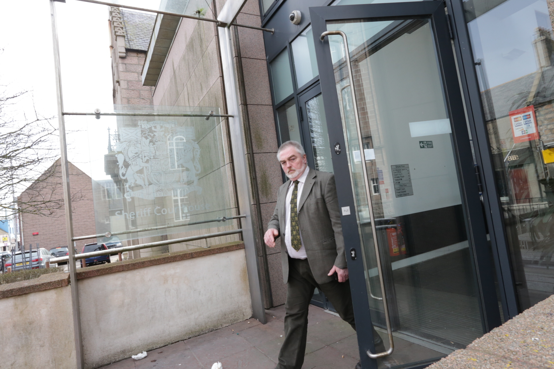 Stephen Quinn leaves court after pleading guilty