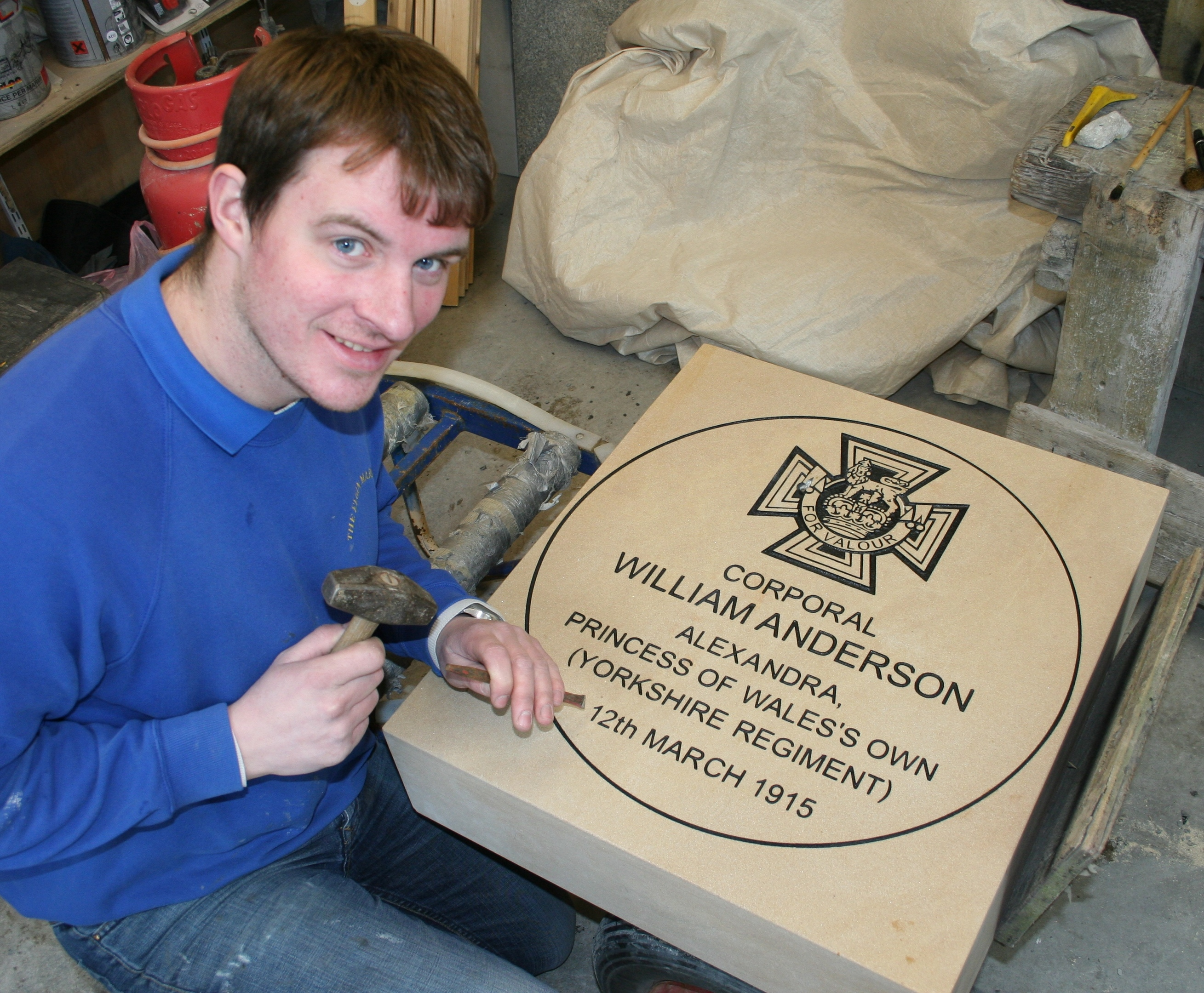 The stone being inscribed by John Ross, a fourth-generation employee of the family firm J.R. Henderson and Sons of Elgin.