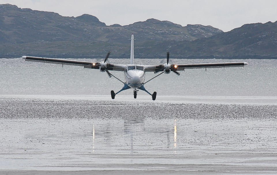 A plane lands at Barra Airport