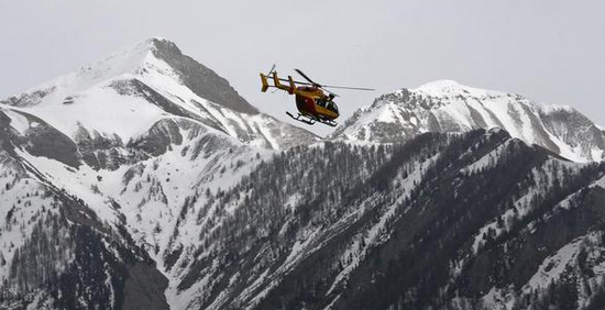 A search helicopter flies into the mountains to locate the crash.