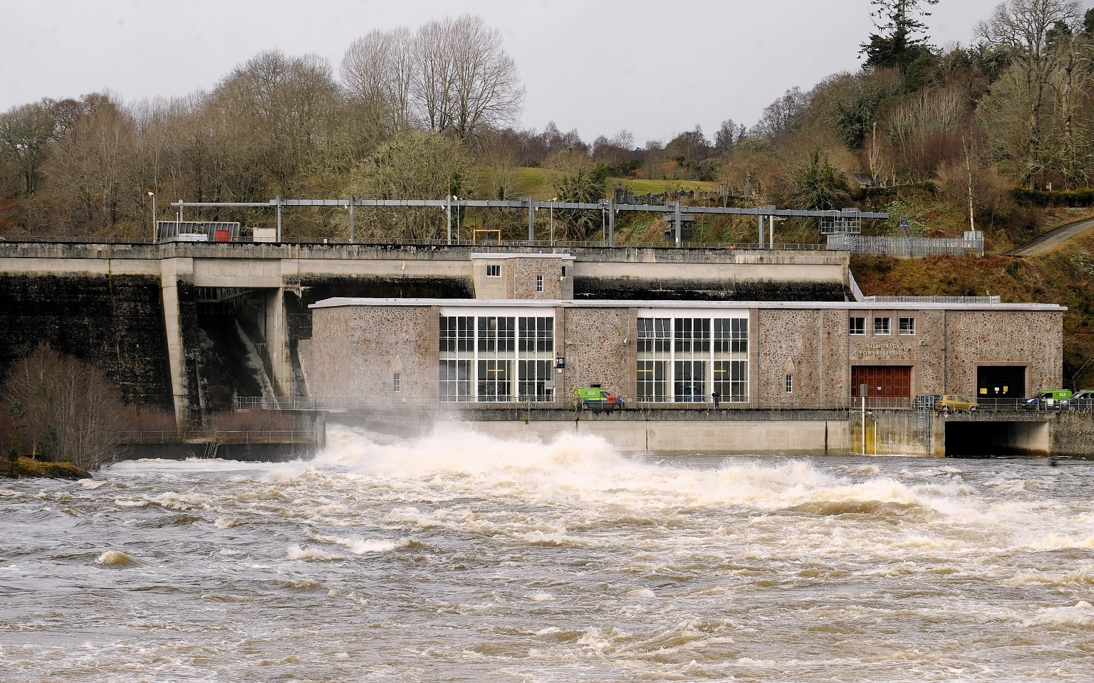 Flood waters of the River Beauly pour over the Kilmorack dam yesterday morning