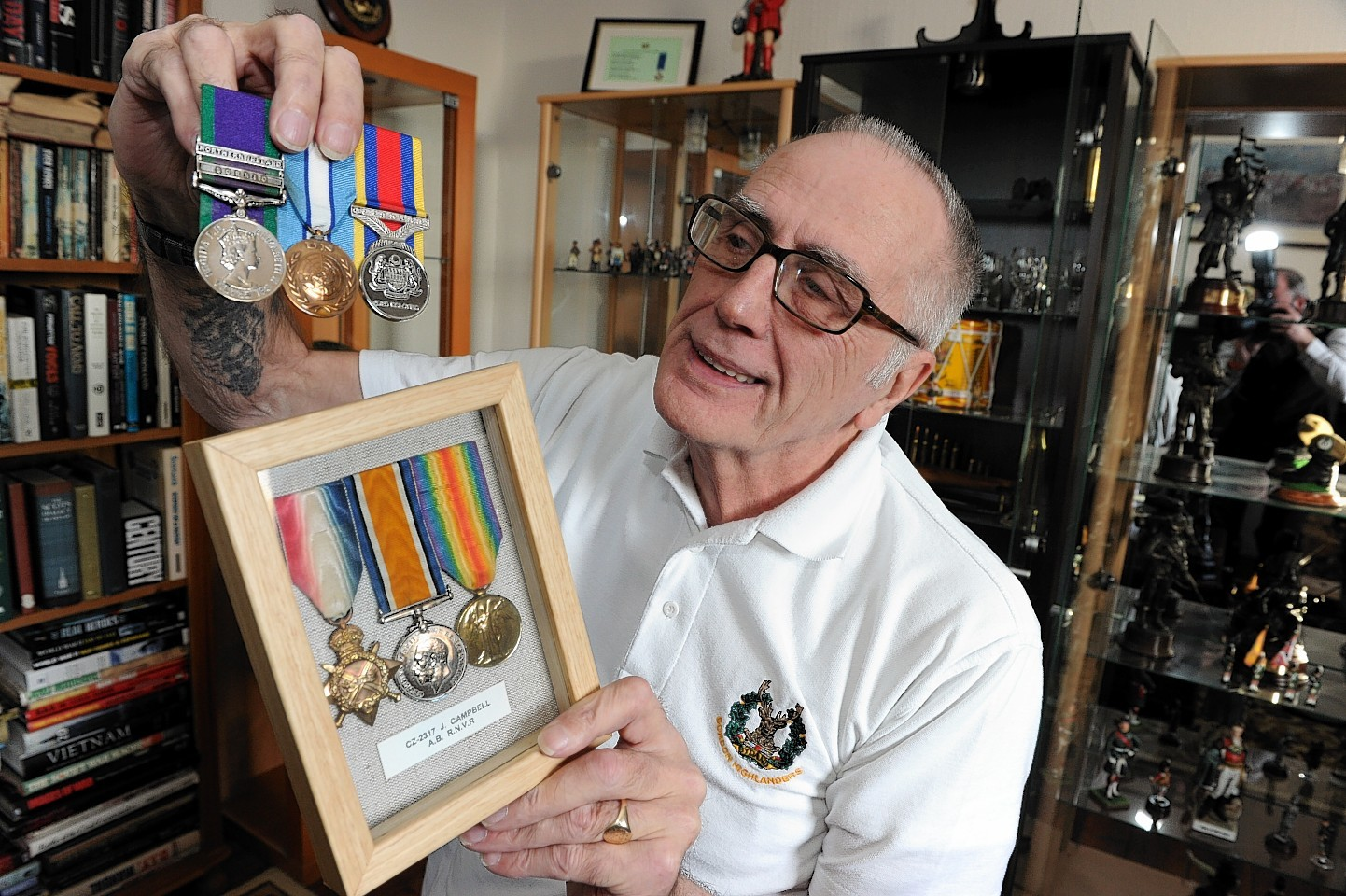 Gordon Highlander George Campbell at his home in Old Rayne with  his medals