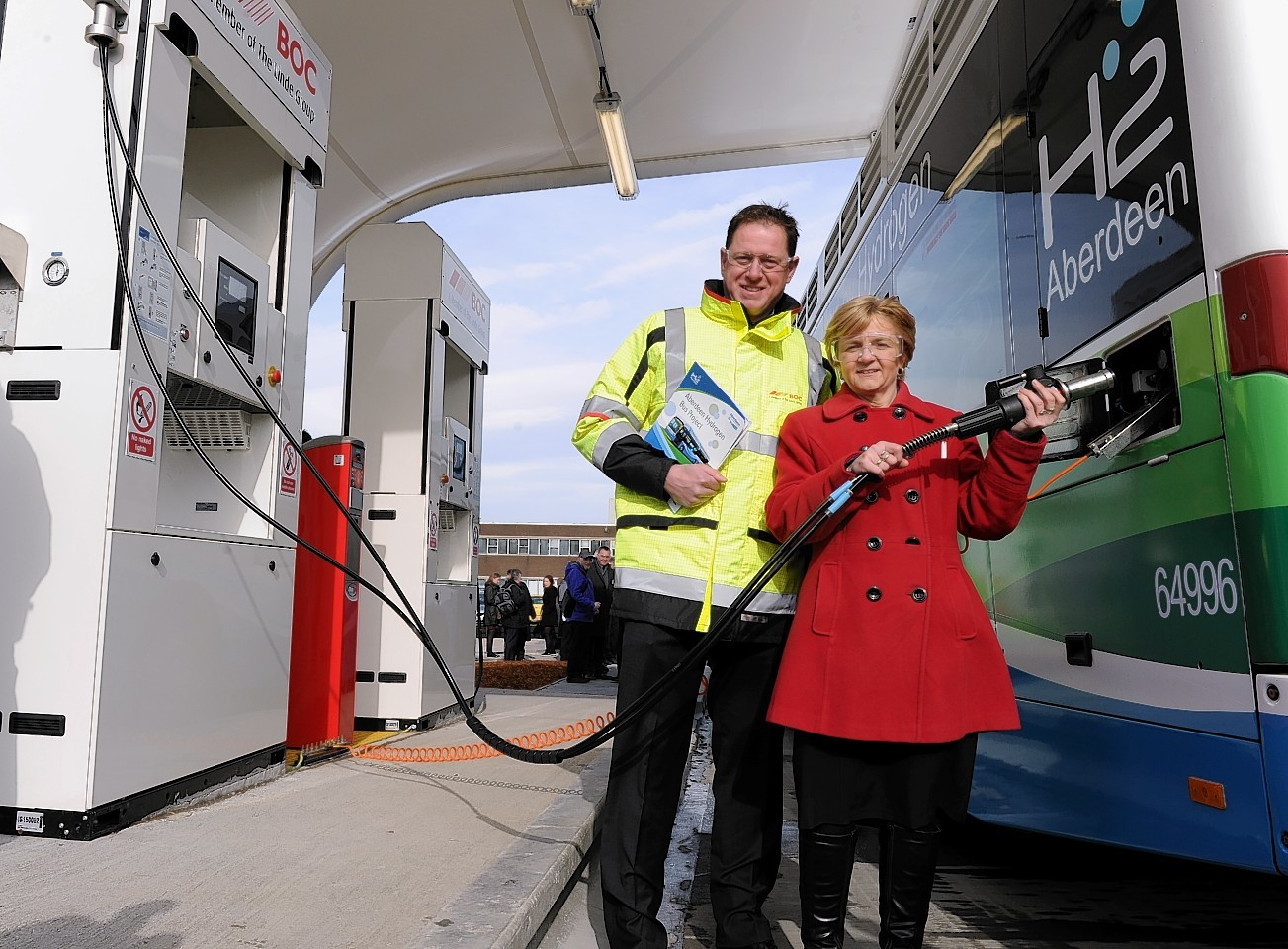 The UK's largest hydrogen production and bus refueling station opens in Aberdeen. BOC's director of Bulk and Packaged Gases Nathan Palmer and Aberdeen City Council leader Jenny Laing 'fills' up the bus. Picture by COLIN RENNIE   March 11, 2015.
