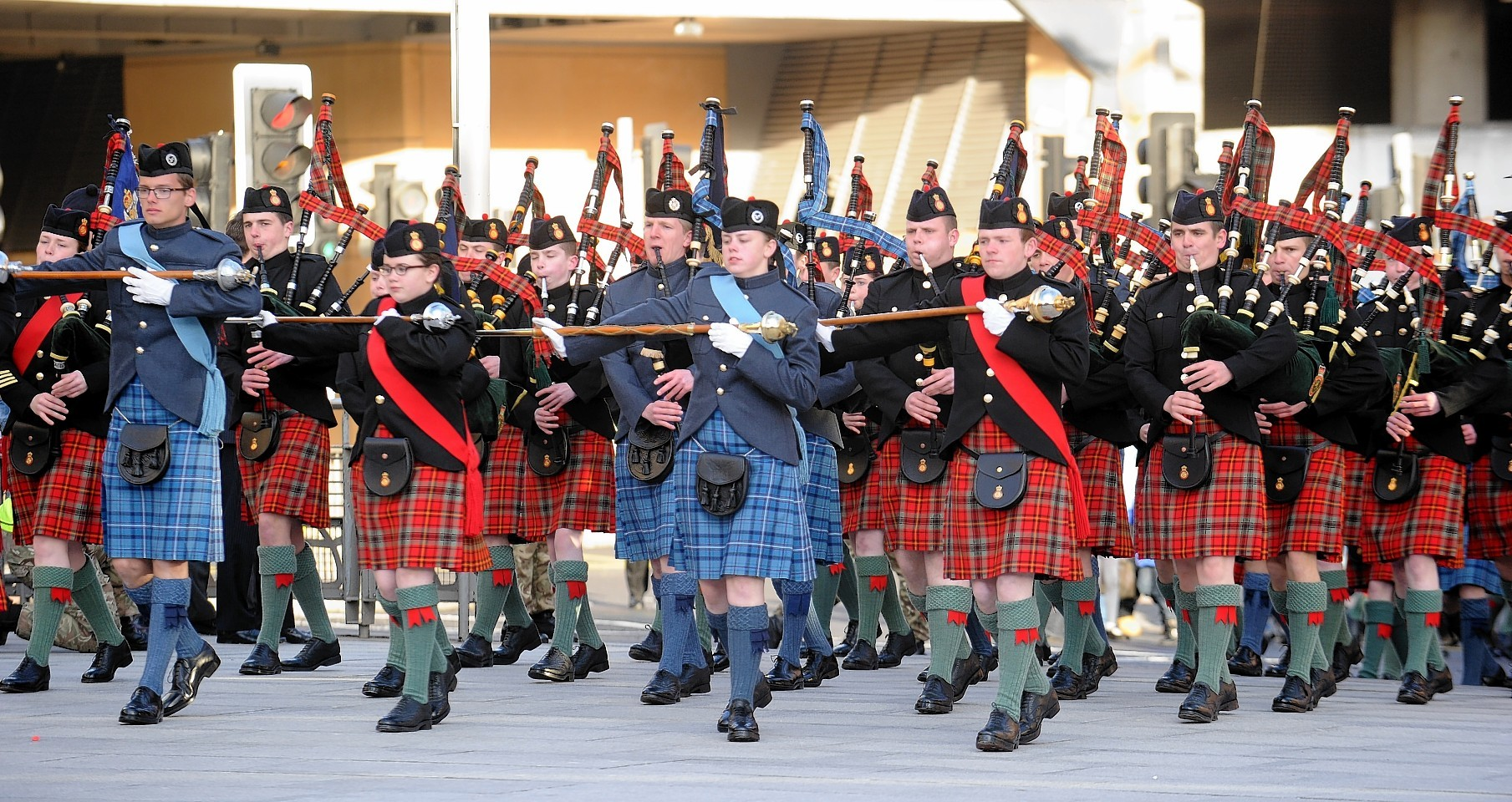 Around 100 pipers and drummers marched in Falcon Square