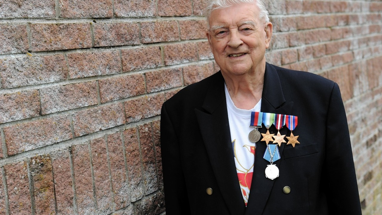 Arctic Convoy veteran, Bob Owen, outside the Westhill Men's Shed