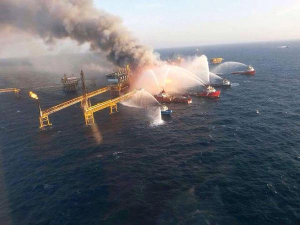 Emergency crews battle the oil rig fire in the Gulf of Mexico