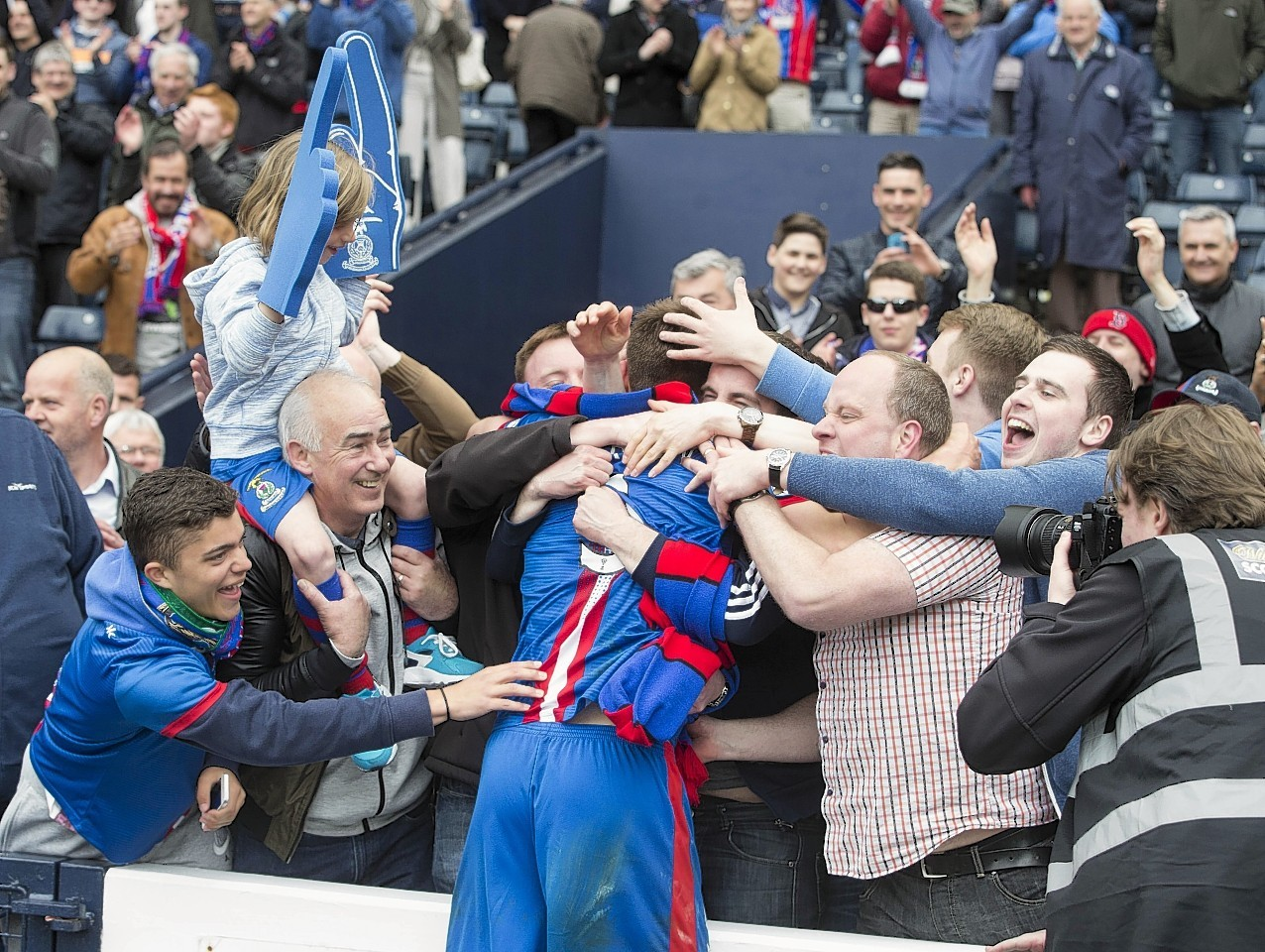 Inverness's Gary Warren celebrates with fans