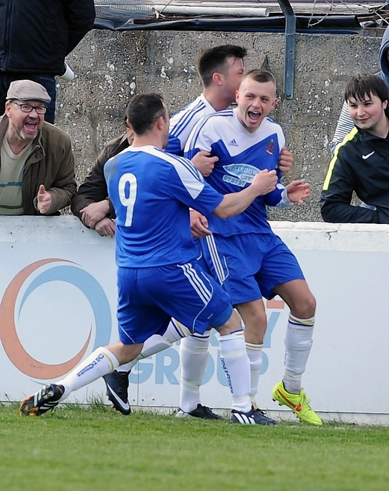 Cove celebrate netting the opening goal from the penalty spot.