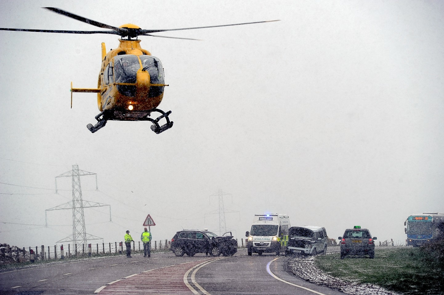 The air ambulance approaches the crash. Picture by Kenny Elrick.