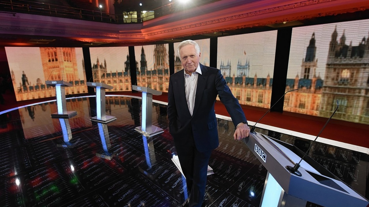 Presenter David Dimbleby gets ready to host this evening's debate