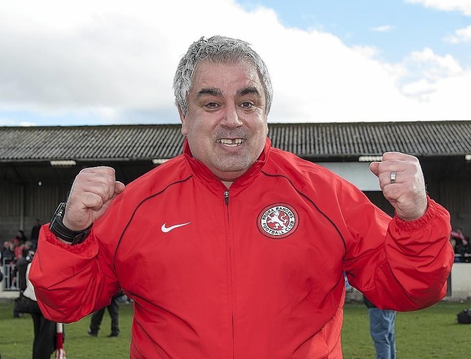 Brora manager Davie Kirkwood celebrates