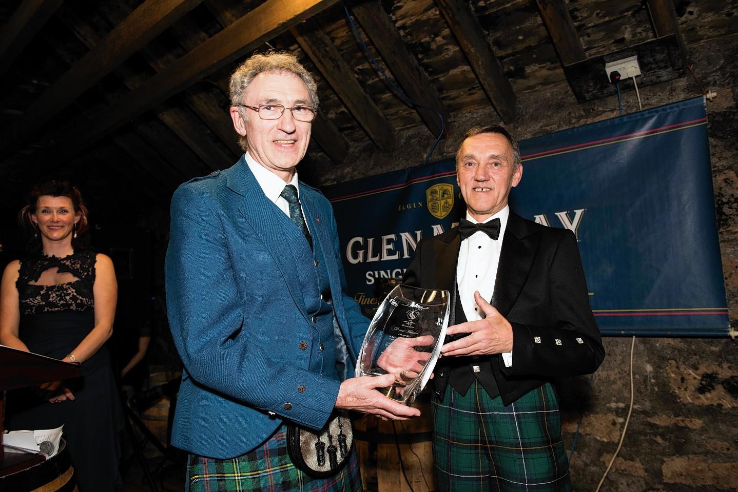 Dennis Malcolm receives  Spirt of Speyside Whisky Festival award