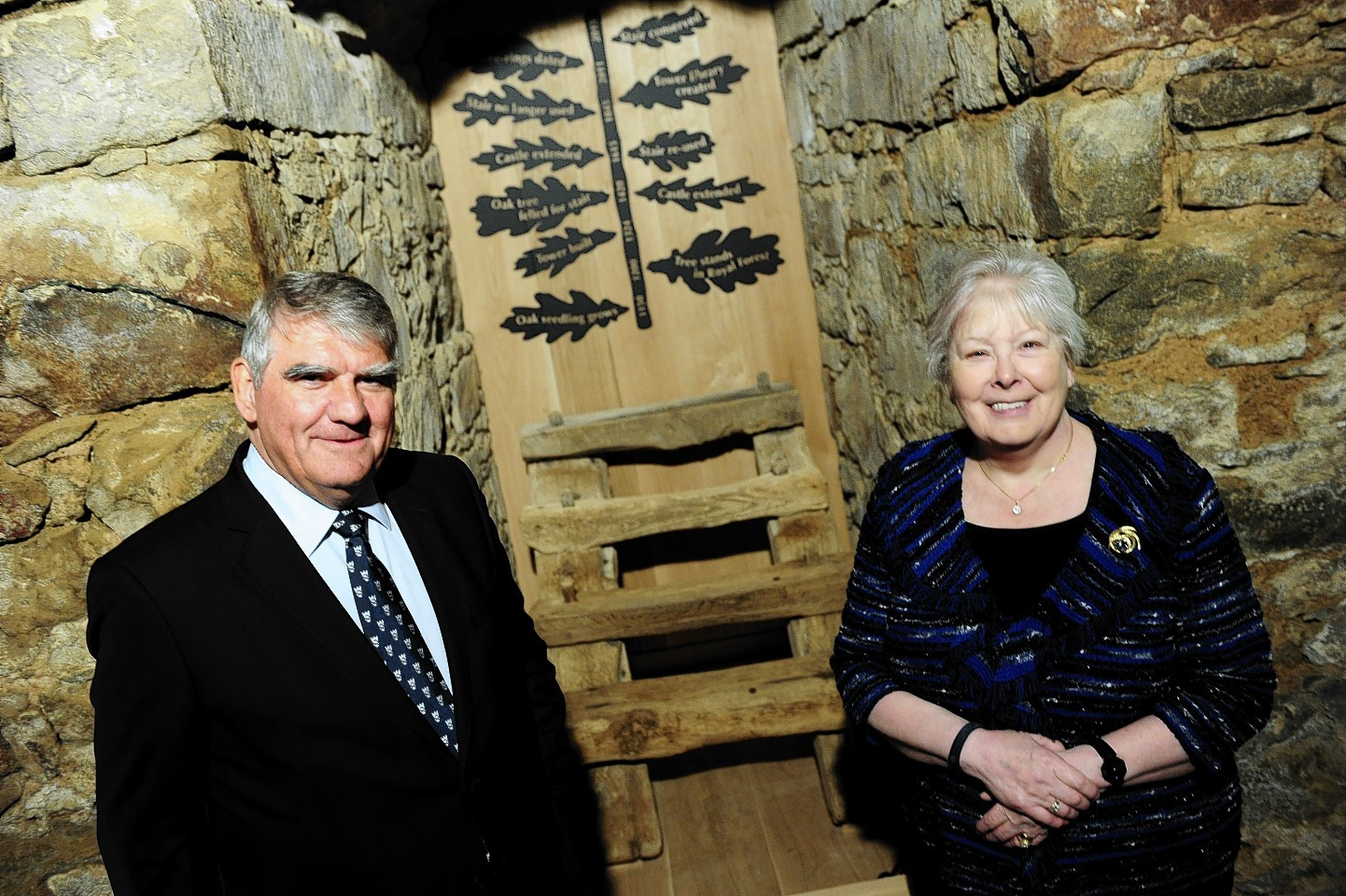 One of Scotland's oldest surviving wooden stairs (from the 1400's) has been conserved and placed on display at Drum Castle, Aberdeenshire.n      Pictured - Chairman of the National Trust for Scotland Sir Moir Lockhead and Chair of the Trust's US Foundation Helen Sayles at the steps in the tower of Drum Castle.     Picture by Kami Thomson