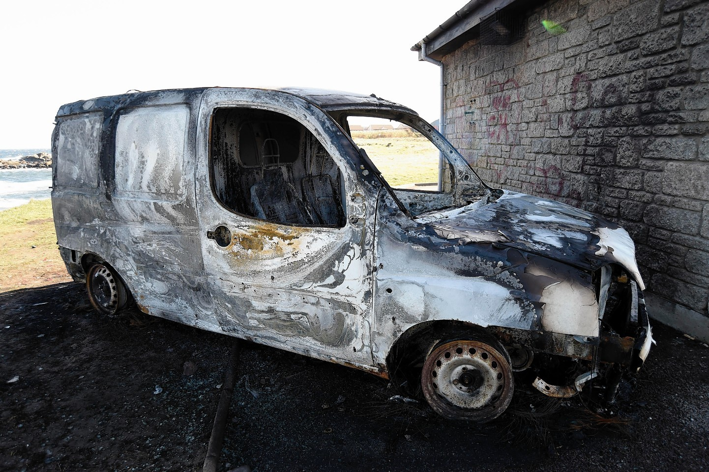 The burned out van
