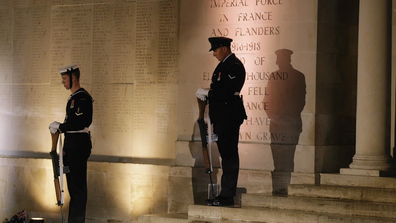 Australian soldiers stand in front of a World War I monument during ANZAC Day service at the Australian National Memorial in Villers-Bretonneux, northern France