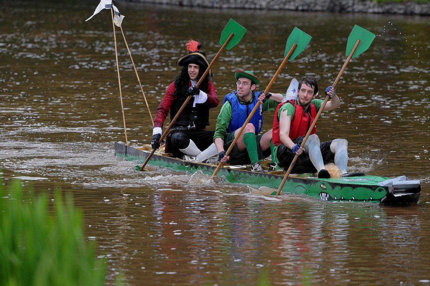 Previous raft race competitors on Peter Pan's alligator