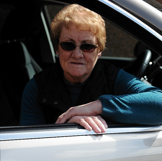 Gladys Simpson, with her mobility VW Tiguan, with the vandalised scratch on the driver's door. Picture by Gordon Lennox