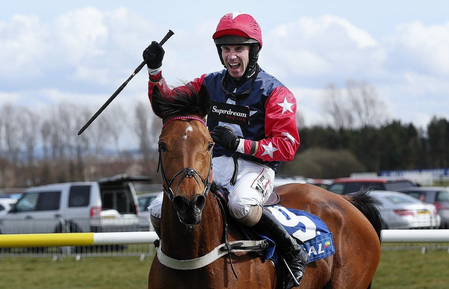 Wayne Hutchinson riding Godsmejudge celebrates winning the The Scottish Grand National Handicap Steeple Chase at Ayr