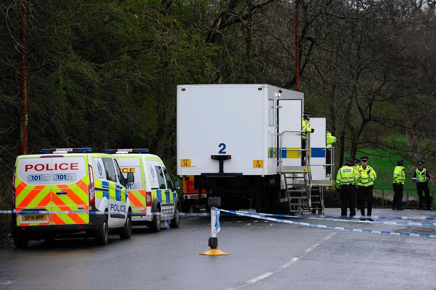 Police scene of crime teams scoured the park