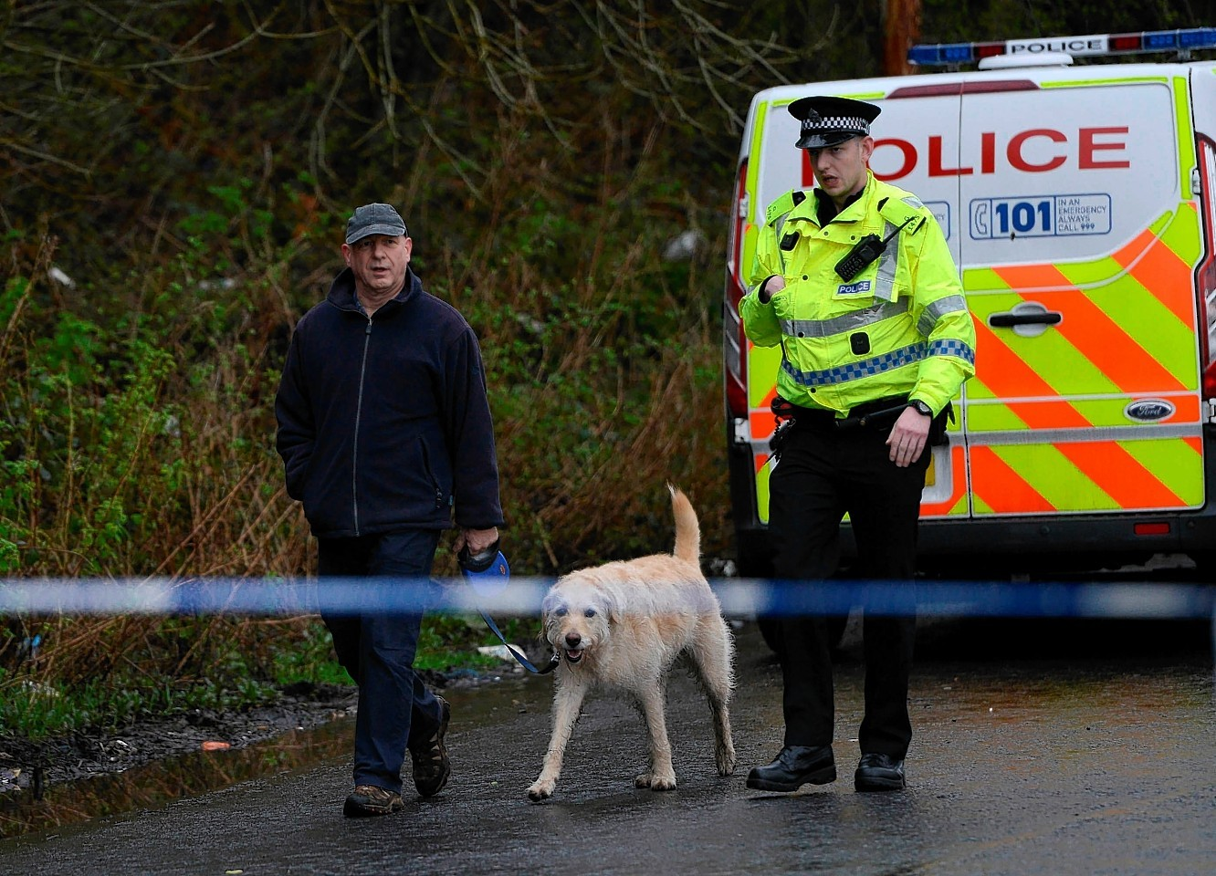 Police continue to search Dawsholm Park, Glasgow, April 15, 2015, where police say the hand bag of missing Irish student Karen Buckley, 24, was found