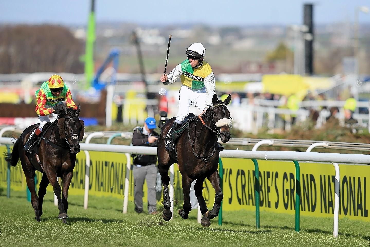 Jockey Leighton Aspell celebrates on board Many Clouds after victory in last year's Grand National