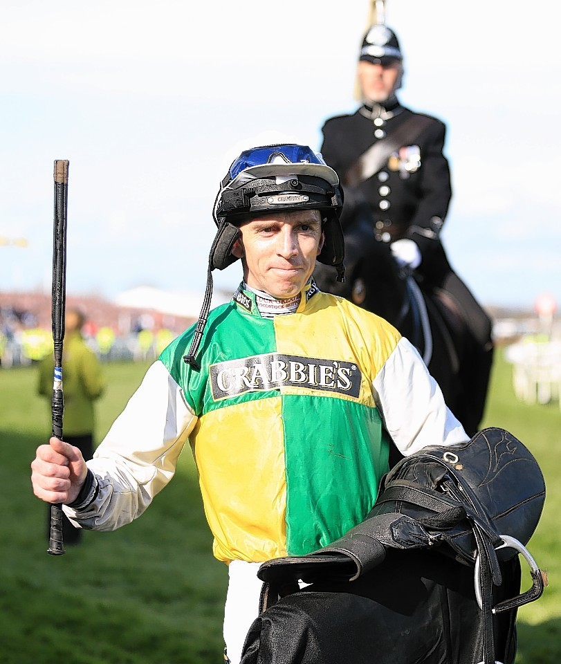 Jockey Leighton Aspell celebrates after Grant National victory
