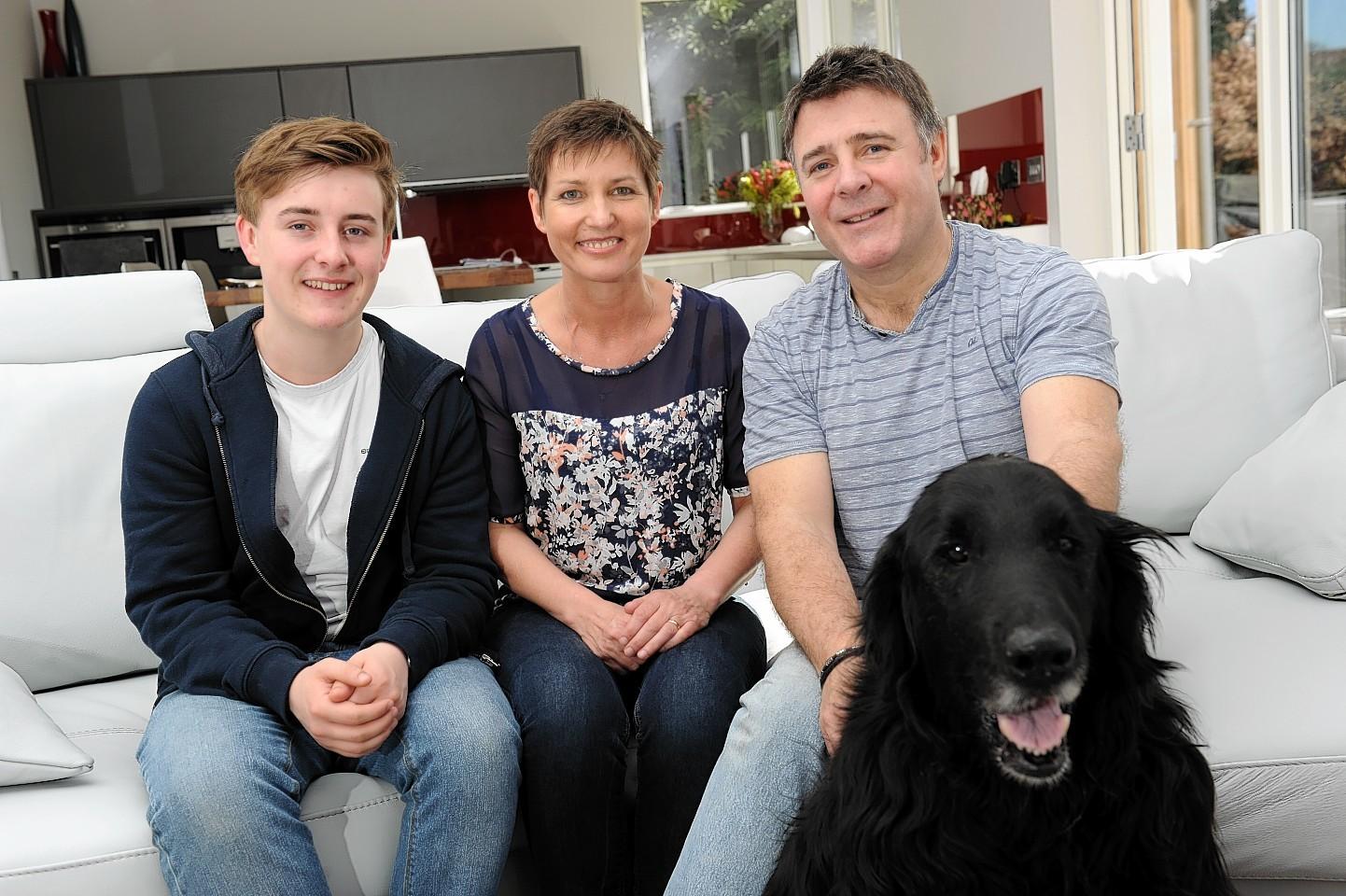 Lisa with son Luke and husband Phil.