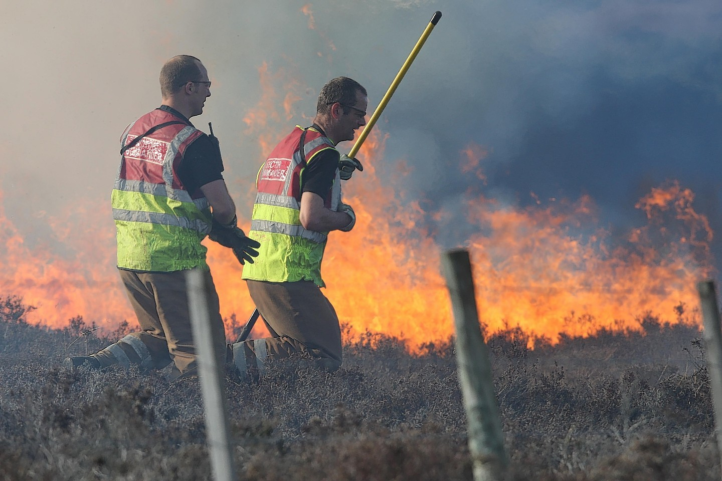 Firefighters tackle the large moorland fire near Inverness
