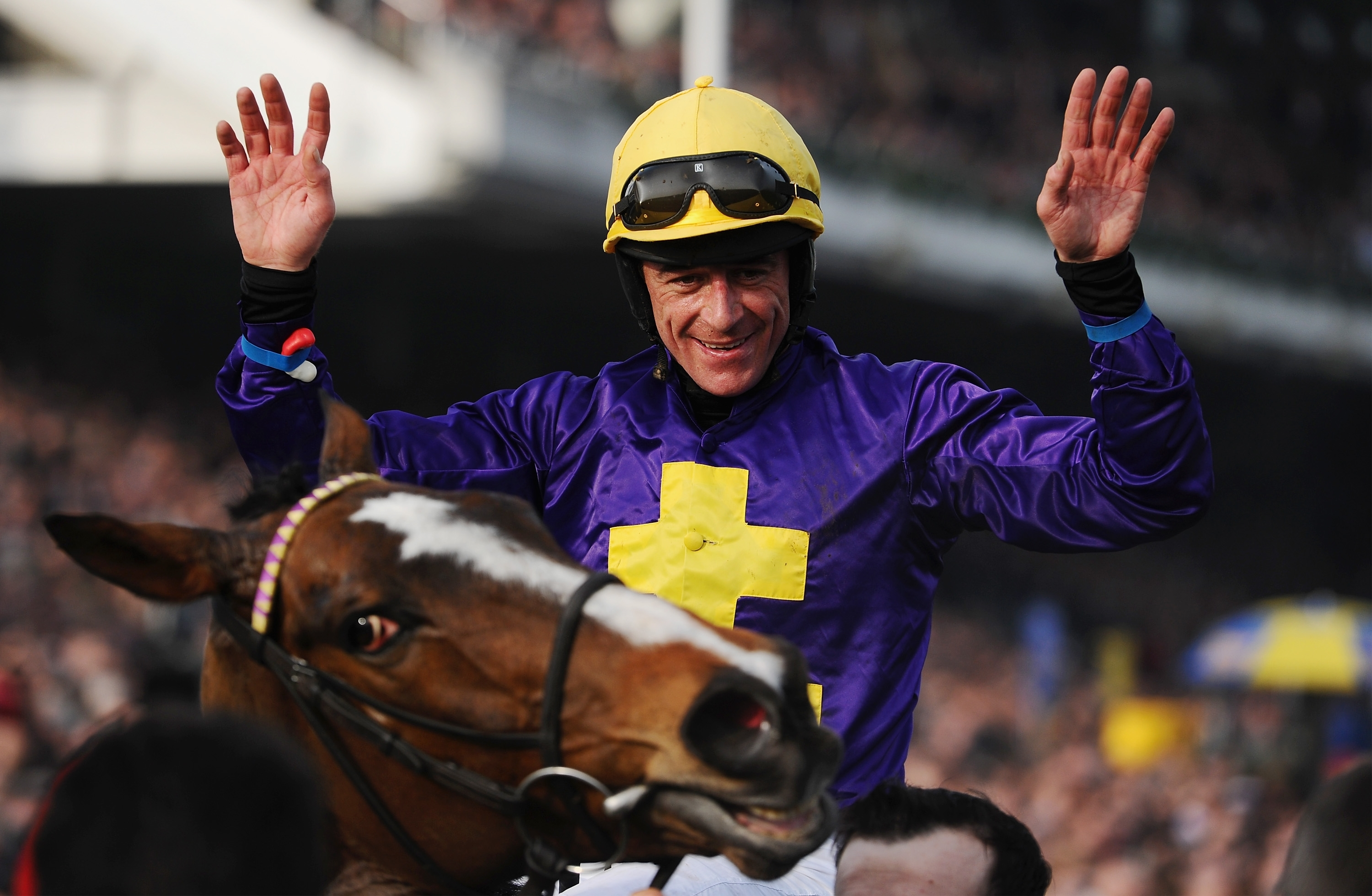 Davy Russell on Lord Windemere celebrates winning the Cheltenham Gold Cup at the 2014 festival