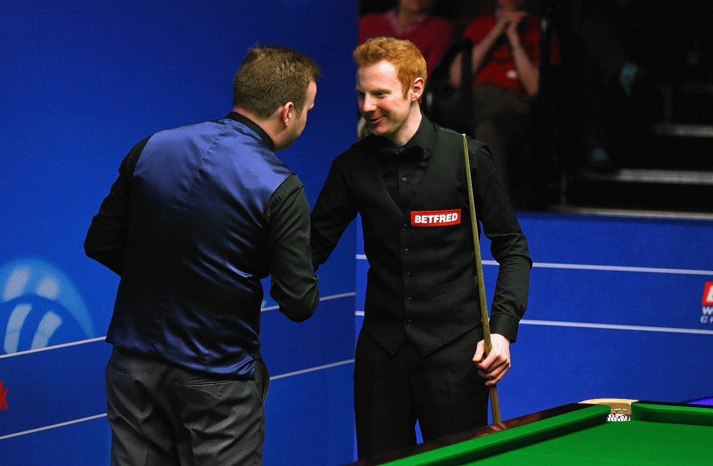 Shaun Murphy shakes hands with Anthony McGill