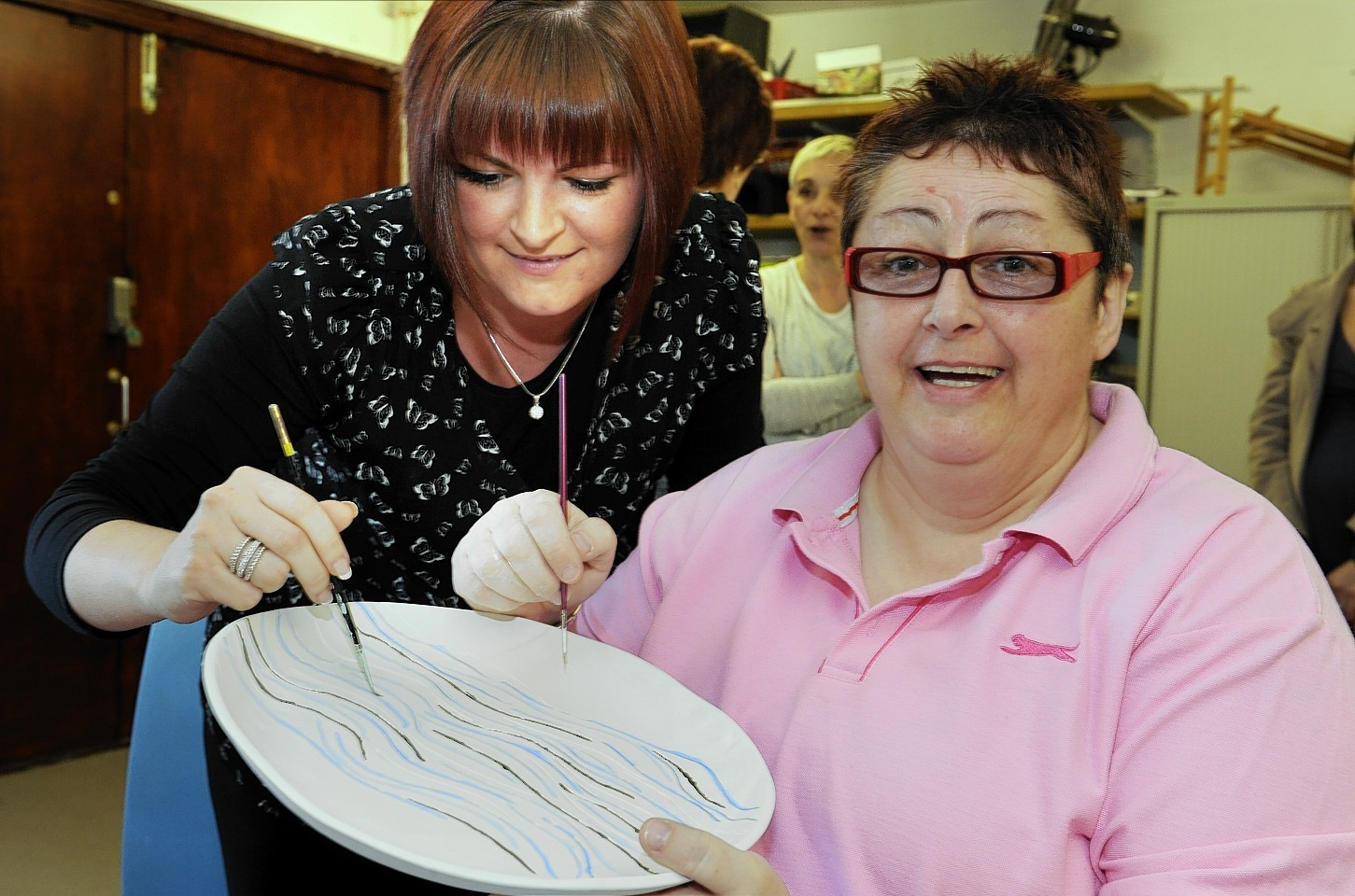 Jade Anderson, of Anderson Anderson and Brown, visits Mental Health Aberdeen's Comraich day centre in Inverurie and meets user  Jackie Craig